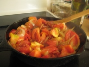 Add tomatoes and give the skillet a stir.